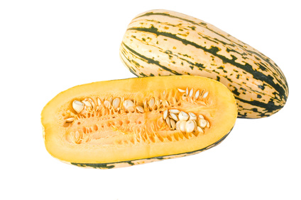 A Delicata squash split open to show it's seeds and inner pulp